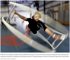 Madison Circus Space member Kristina Whisenhunt spins on a German wheel during a training exercise at the group's temporary location on Madison's East Side last month. The group hopes to have its new facility open later this summer.